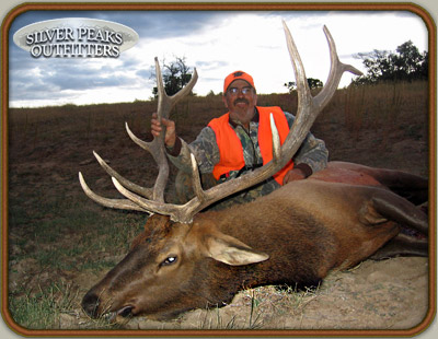 Frank & his 6 pt Colorado Trophy Elk taken with the muzzleloader from Silver Peaks Outfitters Archery and Muzzleloader Hunting Camp #3