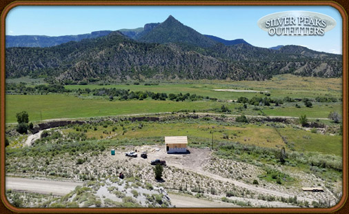 The cabin under construction overlooking some of the irrigated hay fields that attract a variety of Mule Deer & Elk